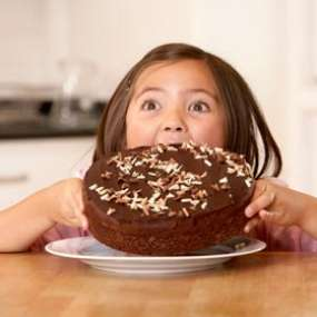 girl-eating-chocolate-cake-280X280